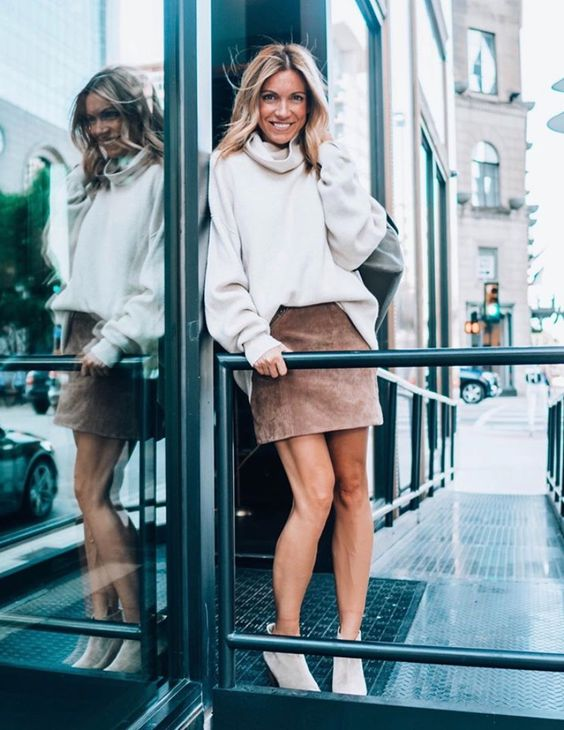 a blush suede mini skirt, an oversized turtleneck sweater, white booties for a simple and cool outfit