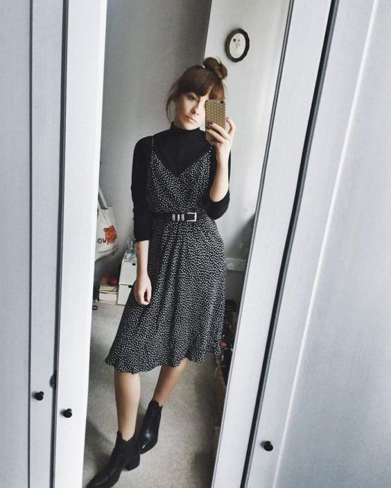 a lovely Parisian chic look with a black turtleneck, a printed black slip dress with a belt, black booties for the fall