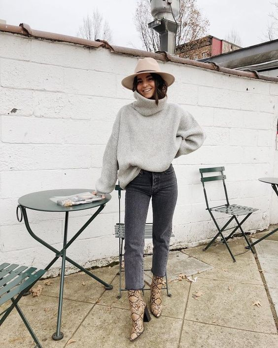 a grey chunky sweater, grey cropped jeans, tan snaekskin print boots and a neutral hat for the fall