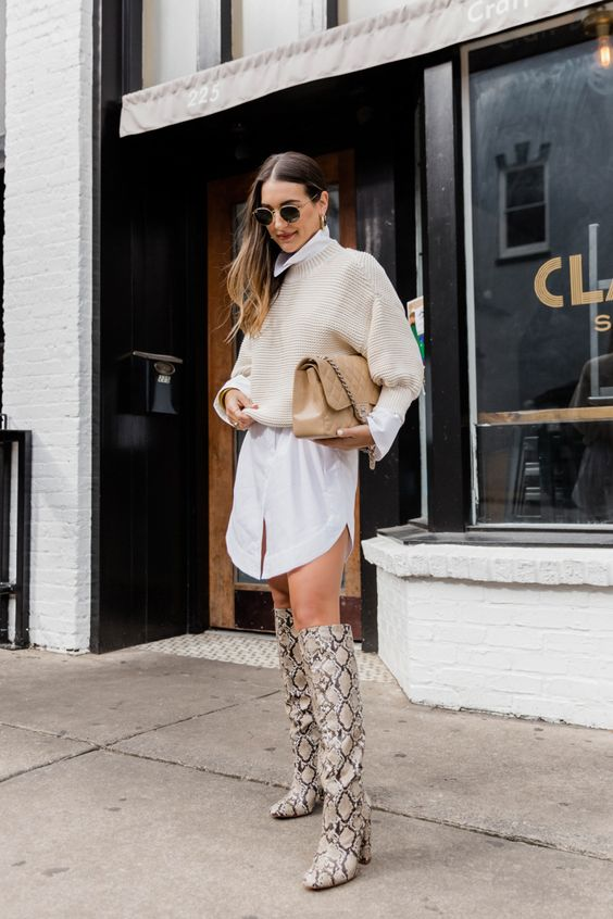 a white shirtdress, a creamy chunky cropped sweater, snakeskin print tall boots and a tan bag for the fall