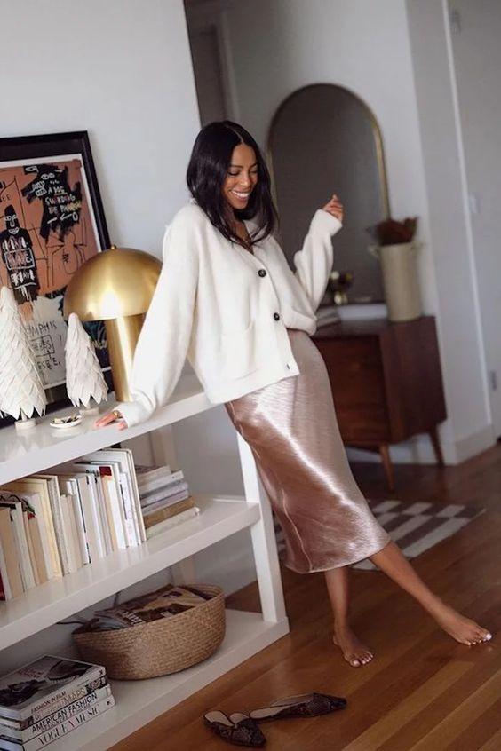 a blush slip midi skirt, an oversized white cardigan, black flat mules for a cute girlish look