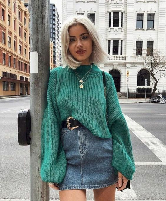 a lovely and girlish outfit with a green chunky sweater, a blue denim mini, a black belt and layered necklaces
