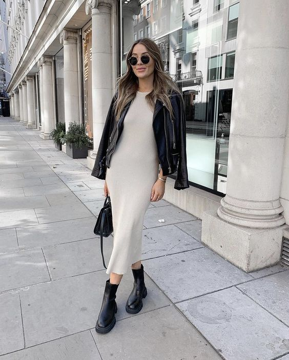 a neutral midi dress, black Chelsea boots, a black leather jacket and a black bag for a minimal and chic look