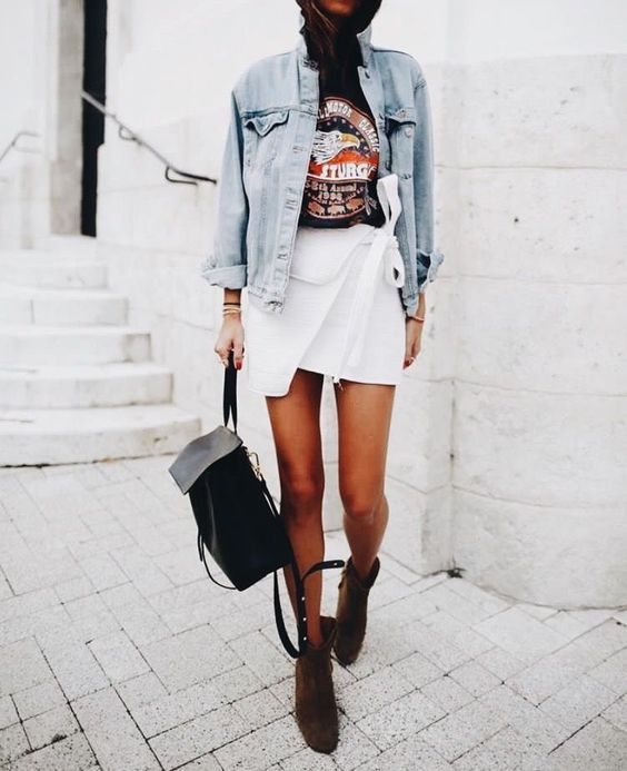 a simple look for a warm day - a printed t-shirt, a white wrap mini skirt, brown boots, a bleached denim jacket and a black backpack