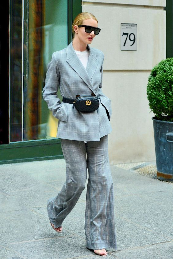 a grey plaid oversized pantsuit with wide leg pants, a white t-shirt, a black waist bag and nude heels