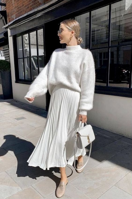 a total white look with a fuzzy sweater, a pleated midi skirt, tan mules, a white bag is an amazing idea