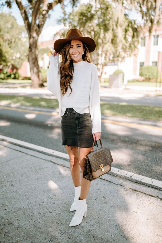 a white sweatshirt, a black denim mini, white boots, a two tone bag and a brown hat for a fall outfit