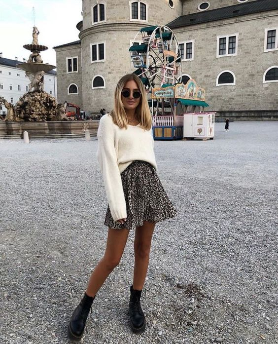 a simple and lovely fall look with a white jumper, a leopard print mini skirt, black combat boots and round sunglasses