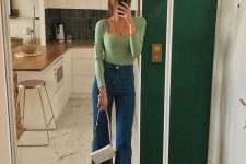 French style outfit with a green square cut top, blue flare jeans, white square toe shoes and a white bag