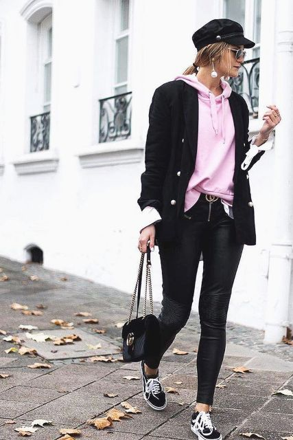 With black cap, leather pants, chain strap bag and black and white shoes