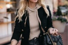 With black chain strap bag and dark gray jeans