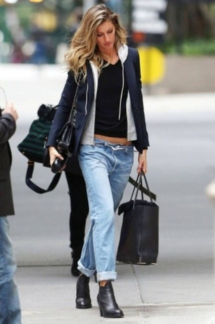 With black chain strap bag, cuffed jeans and black ankle boots