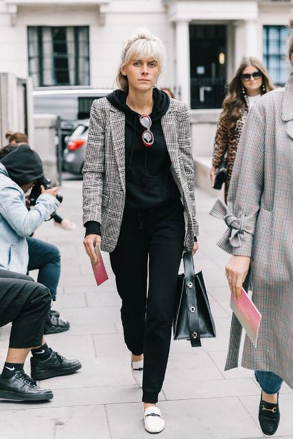 With black jogger pants, black leather tote bag and white flat shoes