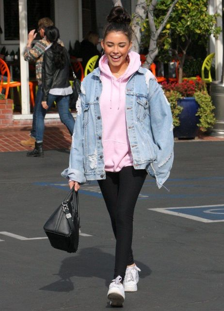 With black leggings, black leather bag and white sneakers