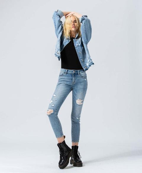 With black shirt, black leather lace up flat boots and denim jacket