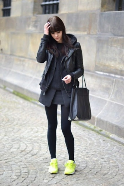 With black skirt, green sneakers and black tote bag