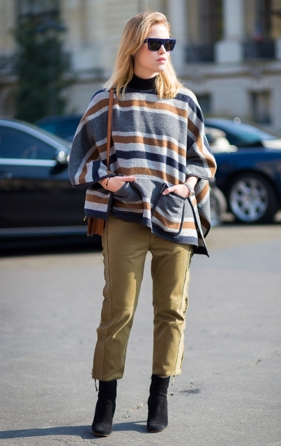 With black suede ankle boots, striped poncho and brown bag