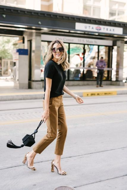 With black t-shirt, black tassel bag and leopard printed high heels