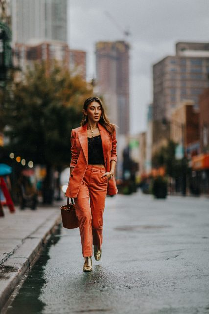 With black top, brown leather basket bag and golden heeled ankle boots
