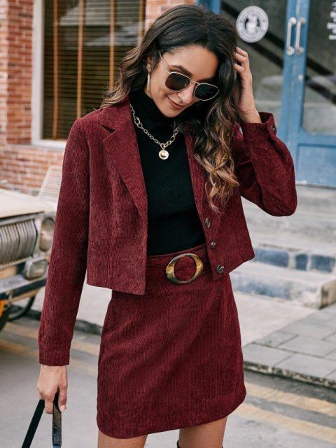 With black turtleneck, necklace, sunglasses and black bag