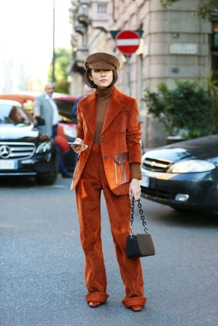 With brown corduroy cap, brown turtleneck, brown chain strap bag and leather boots