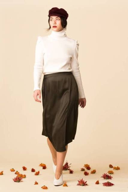 With cap, midi skirt and white shoes