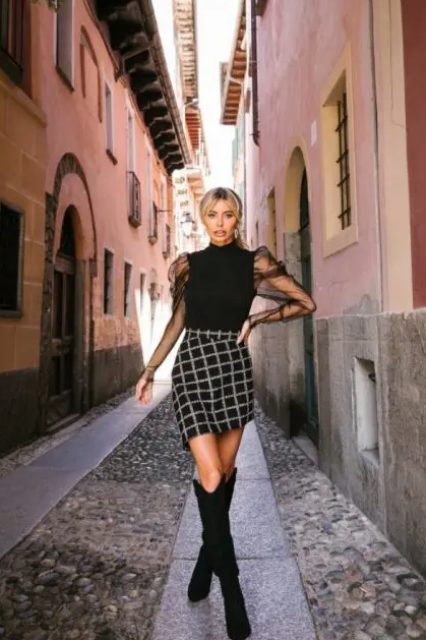 With checked asymmetrical skirt and black high boots