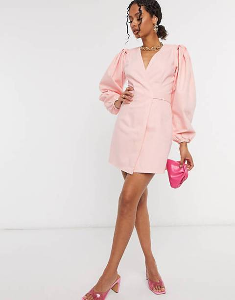 With golden necklace, pink leather mini clutch and pale pink transparent mules