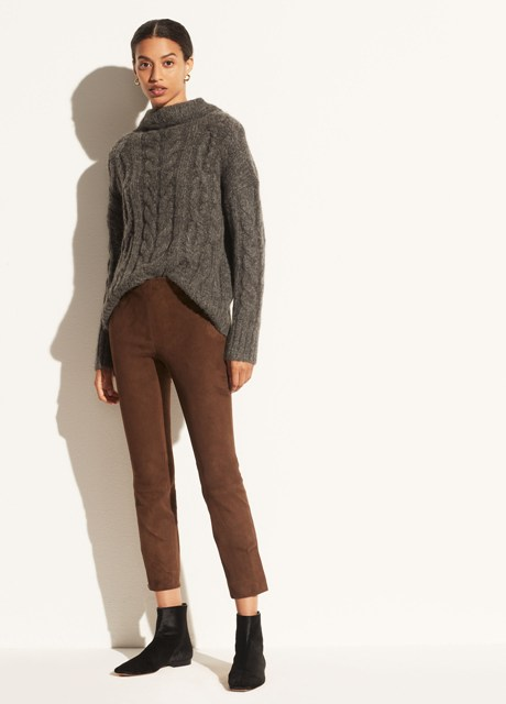 With gray loose sweater and black flat ankle boots