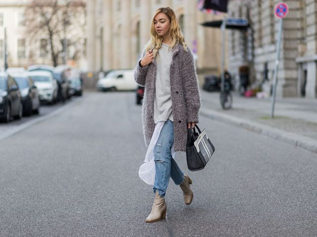 With gray loose sweatshirt, light gray leather boots, coat and three colored bag