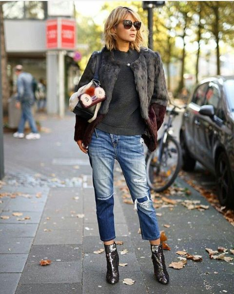 With gray sweater, faux fur jacket, silver boots and bag