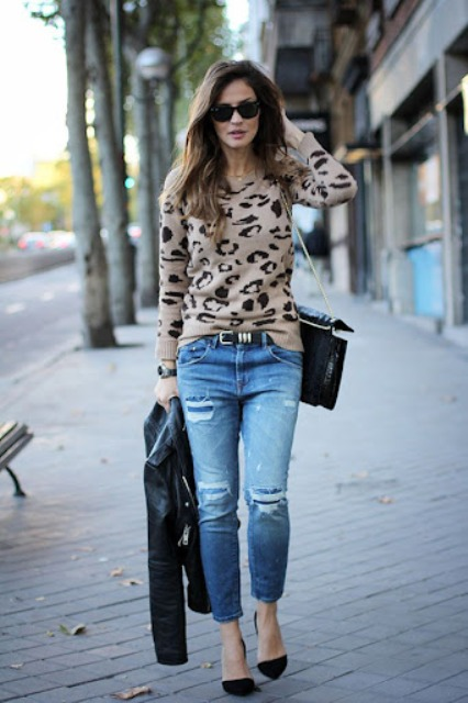 With leopard printed sweater, black chain strap bag and black pumps