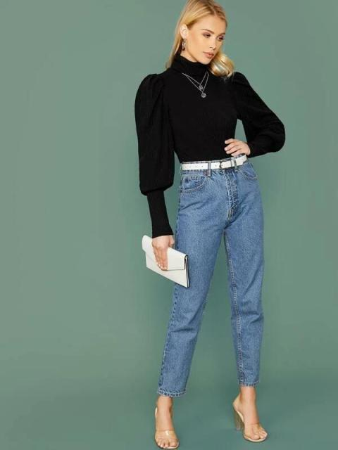 With loose jeans, white belt, white clutch and transparent high heels