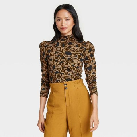With mustard yellow high-waisted pants