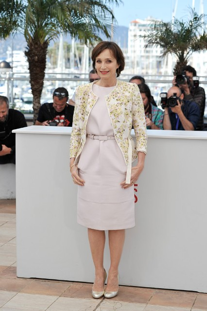 With pale pink belted dress and beige pumps