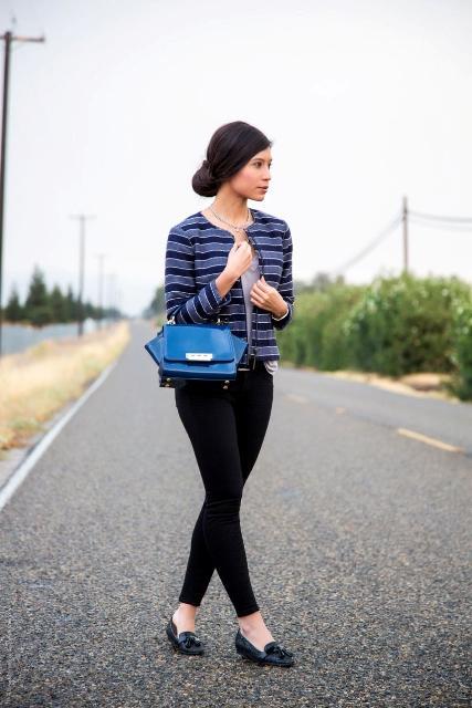 With shirt, black skinny pants, blue bag and black flat shoes