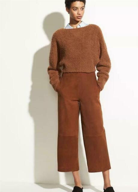 With shirt, brown sweater and black shoes