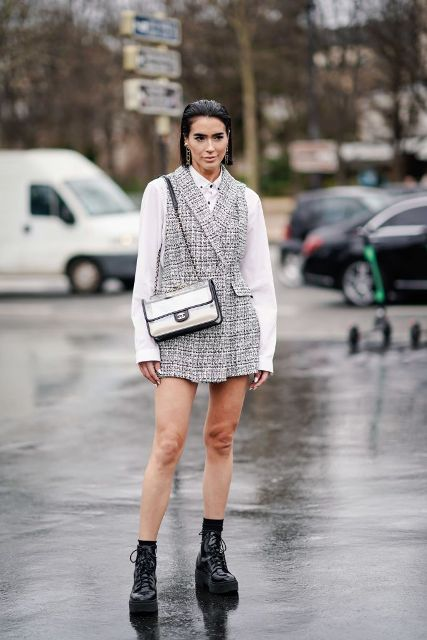 With white button down shirt, silver bag and black lace up platform boots