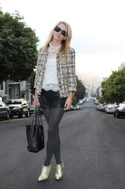 With white lace blouse, black leather shorts, gray tights, metallic ankle boots and tote bag