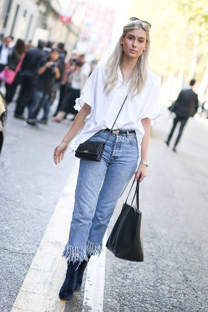 With white loose button down shirt, black crossbody bag, black tote bag and navy blue velvet boots