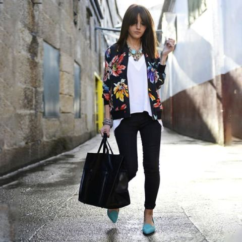 With white loose shirt, skinny pants, black leather tote bag and low heeled shoes