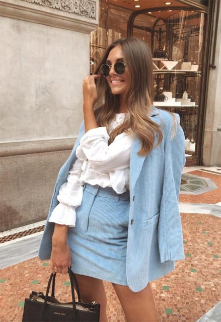 With white ruffled blouse, rounded sunglasses and black leather tote bag