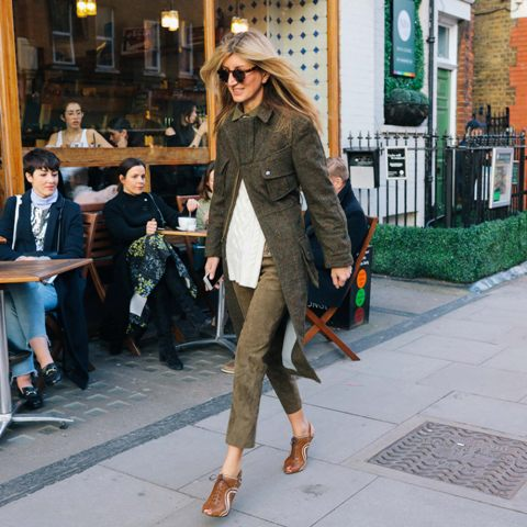 With white shirt, tweed jacket and brown lace up ankle boots
