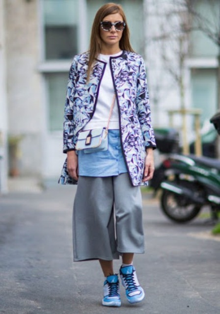 With white sweatshirt, light blue button down shirt, pastel colored chain strap bag, gray culottes and colorful sneakers