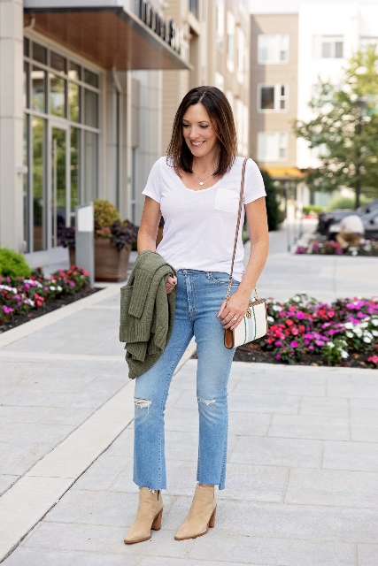 With white t-shirt, bag and beige heeled boots