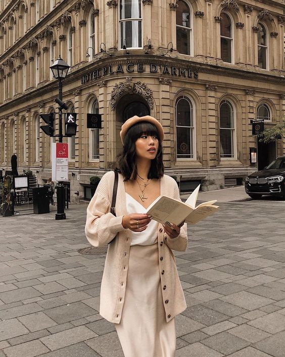 a beautiful neutral look with a white top, a neutral slip skirt, a matching oversized cardigan, a beret and a brown bag