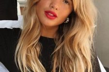 a beautiful textural hairstyle with curtain bangs and messy waves down is a sexy and fab idea for anyone