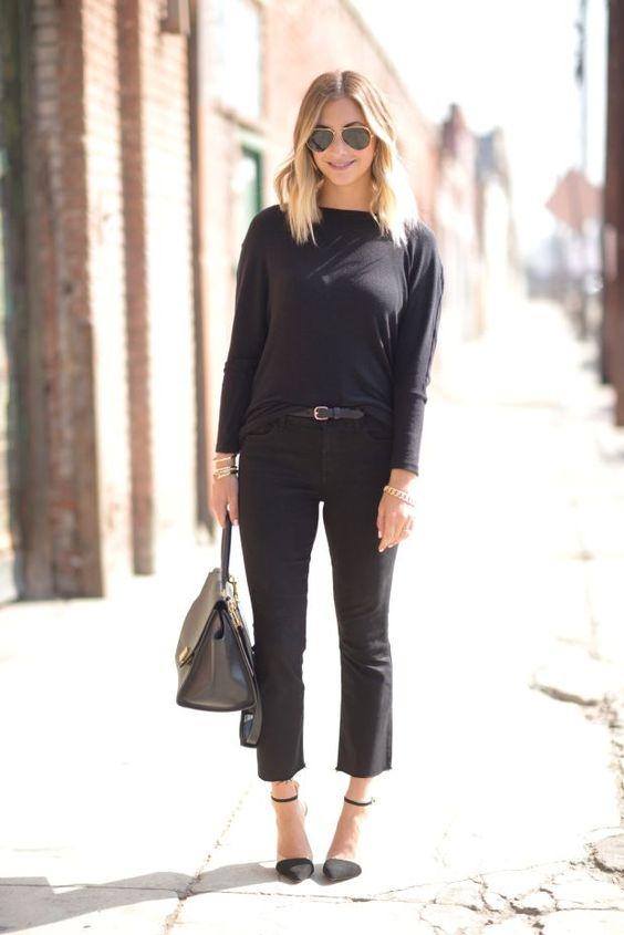 a black jumper, black cropped flare jeans, black ankle strap heels, a grey bag for going to work