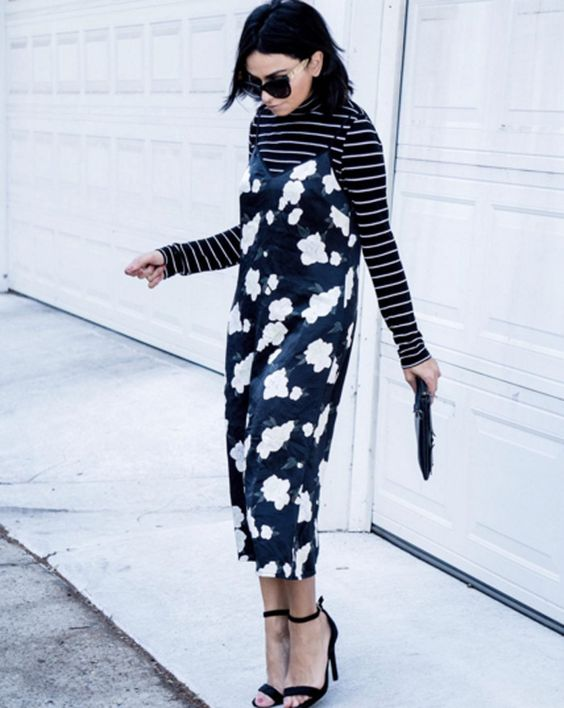 a black striped turtleneck, a black floral slip midi dress, black shoes and a black clutch for a bold look