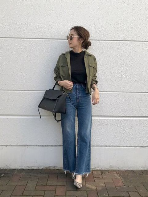 a black top, blue jeans, a green utility jacket, a black bag and snakeskin print shoes